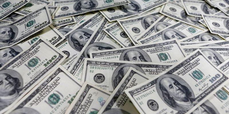 Dollar Slides Amid Economic Reopening Discussions